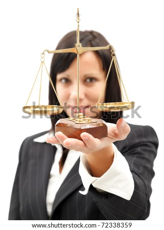 Attractive woman in suit holding scales of justice and a gavel while standing against a white backgr stock photo © wavebreak_media