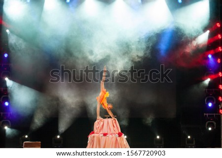 Beautiful sporty woman in black dress slim body with hula hoop Stock photo © bartekwardziak