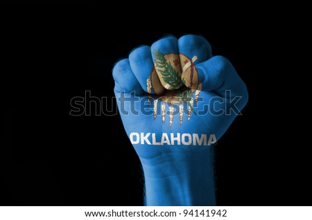 Fist Painted In Colors Of Us State Of Oklahoma Flag Stockfoto © vepar5