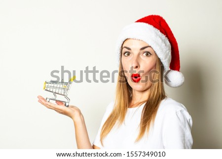 gyönyörű · mikulás · karácsony · lány · bevásárlókocsi · kicsi - stock fotó © vlad_star