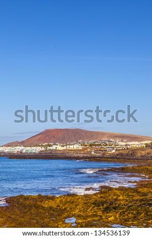 beach and village  of Playa Blanca with the volcano montana Roja Stock photo © meinzahn