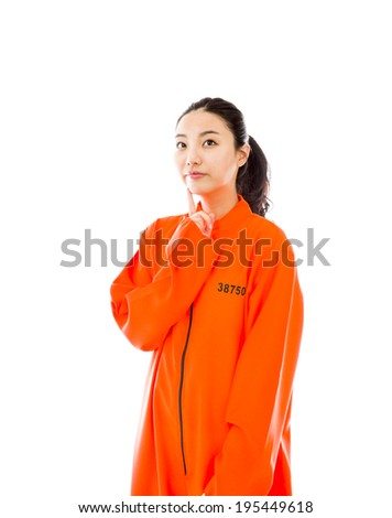 Young Asian woman standing with hand on chin in prisoners uniform Stock photo © bmonteny