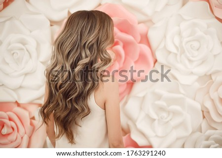 Happy beautiful brunette bride with long wavy hair styling holdi Stock photo © Victoria_Andreas