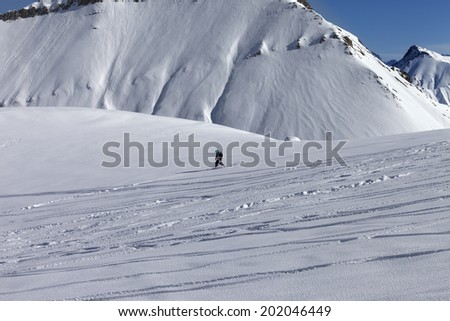 Snowboarder downhill on off-piste slope with newly-fallen snow Stock photo © BSANI
