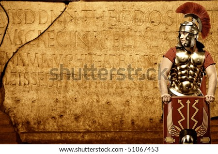 roman legionary soldier in front of wall with ancient writing stock photo © nejron