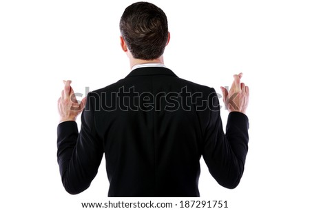 Stock photo: Back view portrait of a businessman making a wish isolated on white background