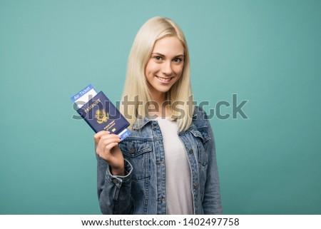 happy tourist young woman holding passport holiday flight ticket stock photo © ichiosea