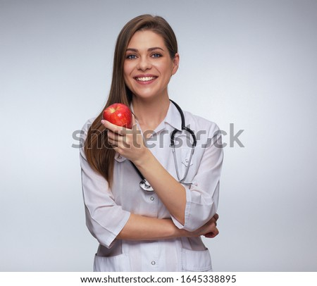 confident female doctor medical professional holding red heart stock photo © ichiosea