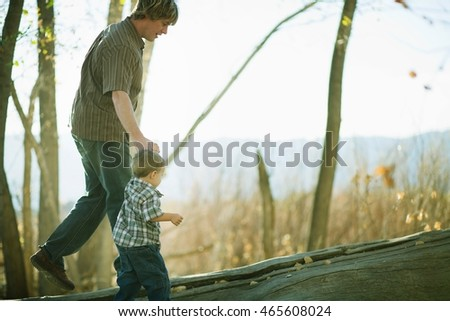 Father guiding young son on log Stock photo © IS2