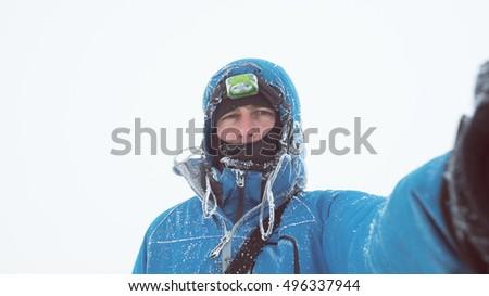Winter selfie portrait of a guy with a hoarfrost on the jacket Stock photo © Kotenko