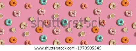 Delicious glazed donuts and cup of coffee on turquoise surface Stock photo © artsvitlyna