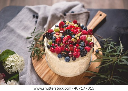 beautiful cake covered with icing cream summer berries on the top stock photo © ruslanshramko