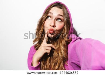 Portrait of adorable woman 20s wearing sweatshirt taking selfie  Stock photo © deandrobot