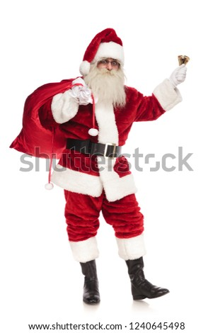 happy santa sings christmas carol while holding bag of presents Stock photo © feedough