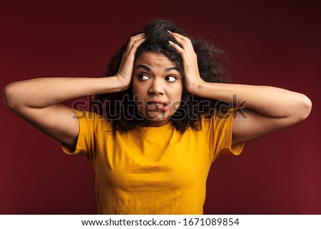Photo of confused african american woman grabbing head, isolated Stock photo © deandrobot
