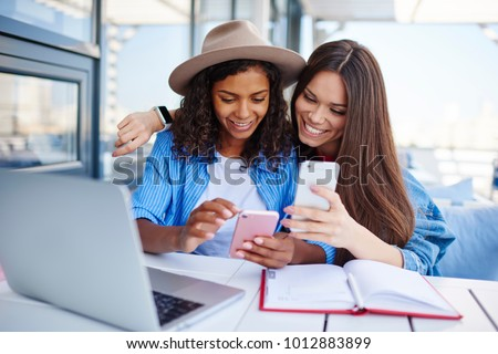 photo of hipster african american girl smiling and talking on mo stock photo © deandrobot