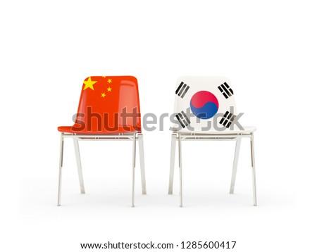 Iki sandalye bayraklar Çin Güney Kore yalıtılmış Stok fotoğraf © MikhailMishchenko