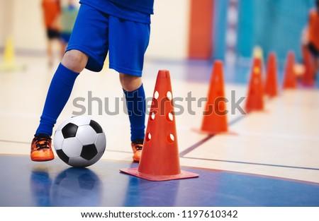 Kids futsal training. Indoor soccer players training with balls. Stock photo © matimix