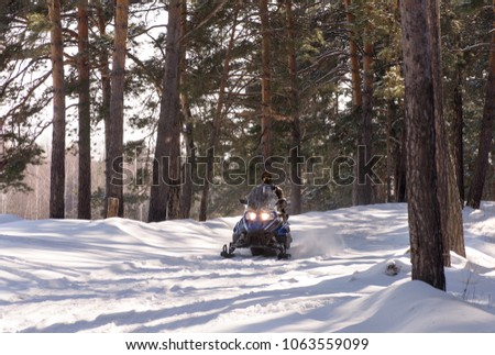 Family on Snowmobile, Snowmobiling People in Park Stock photo © robuart