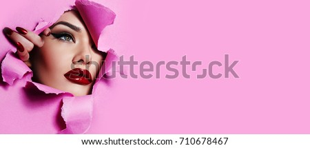 Girl fashion model with bright makeup and red manicure on the nails, lips . jewelry accessories . Wh Stock photo © studiolucky