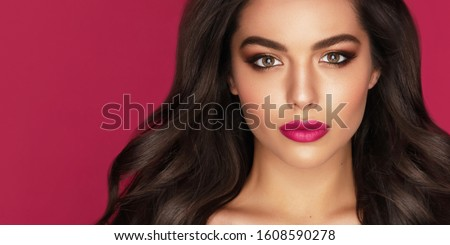 Attractive brunette with professional make-up of flawless face and manicured hand with white nails. stock photo © studiolucky