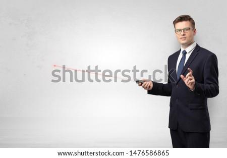 Businessman with laser pointer and copyspace white blackboard Stock photo © ra2studio