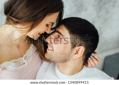 Laughing young people in pajamas playfully posing at sofa. Happy couple smiling in morning Stock photo © ruslanshramko
