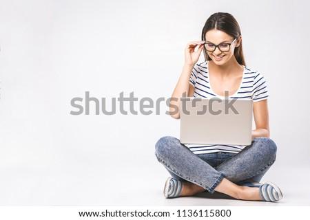 счастливым · сидят · изолированный · серый · используя · ноутбук - Сток-фото © deandrobot