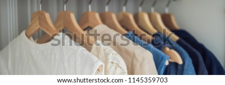 Clothes on hangers in the cabinet gradient from white to dark blue ストックフォト © galitskaya