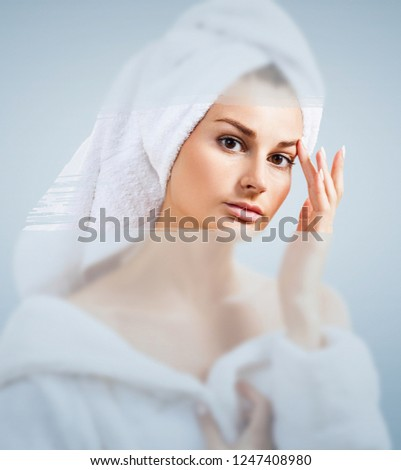 Beautiful woman in the shower behind glass with drops on the background of a window with a panoramic Stock photo © galitskaya