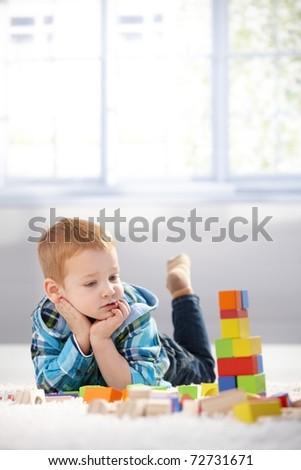 Imádnivaló kicsi fiú fektet padló játszik Stock fotó © ElenaBatkova