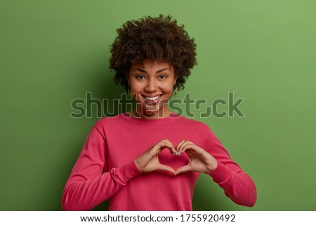 Attractive woman in romantic mood smiling in happiness sitting at table wearing pink jacket Stock photo © ElenaBatkova