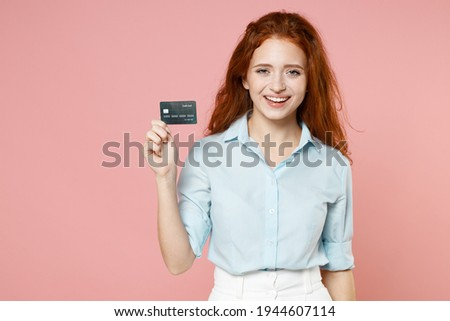Young successful businesswoman with plastic card looking through online goods Stock photo © pressmaster
