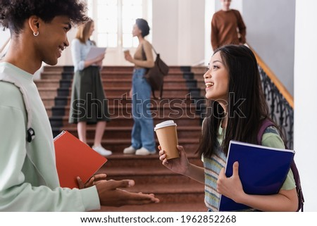 students with notebook and takeaway drinks Stock photo © dolgachov