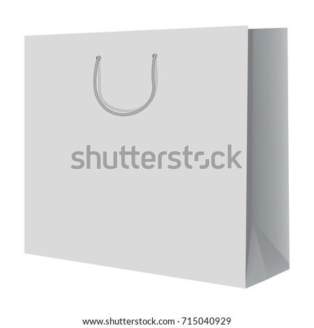 Hand of female shopaholic holding white paperbag with purchase Stock photo © pressmaster