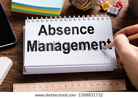 Person Writing Absence Management Word In Notebook With Pencil Stock photo © AndreyPopov
