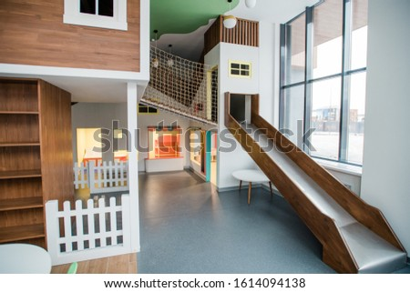 Play area with slide, small house and table with chairs around and lamps above Stock photo © pressmaster