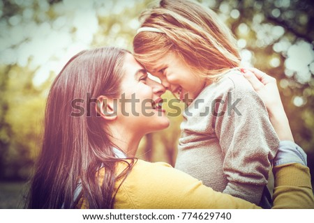 happy young family spending time outdoor in the autumn park Stock photo © Lopolo