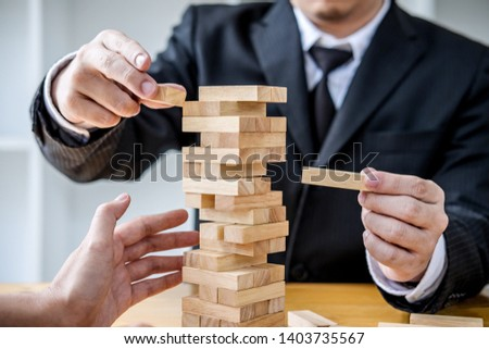 Images of hand of businesspeople placing and pulling wood block  Stock photo © Freedomz