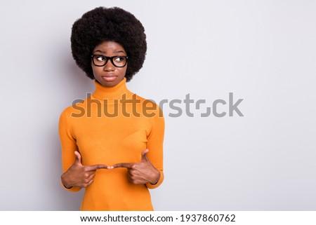 Portrait of unhappy multinational women pointing fingers upward Stock photo © deandrobot
