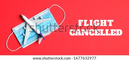 Coronavirus travelling ban sign. Travel cancelled due to COVID-19. NOT TRAVEL text written in pink f Stock photo © Maridav