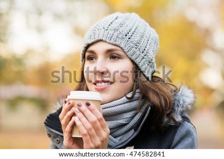 woman drinking takeaway coffee in autumn park Stock photo © dolgachov