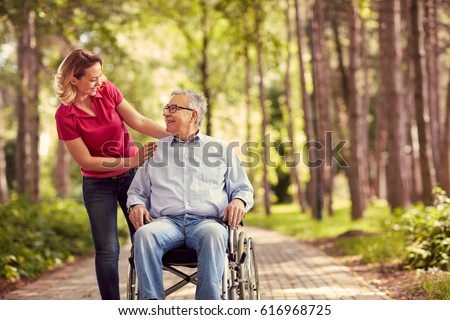Happy Young Woman With Her Old Senior Father On Wheelchair Stock photo © AndreyPopov