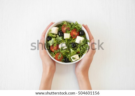 Woman mixing bowl of salad leaves Stock photo © photography33