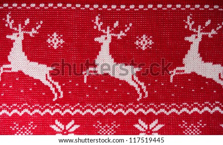 Real red knitted background with white Christmas deers and snowf Stock photo © HASLOO