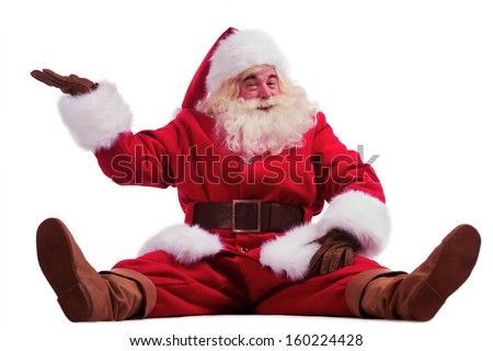 Hilarious and funny Santa Claus showing presenting gesture while Stock photo © HASLOO