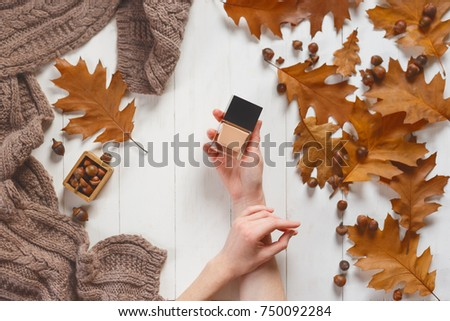Beautiful girl on autumn background holding a white noticeboard Stock photo © Nejron