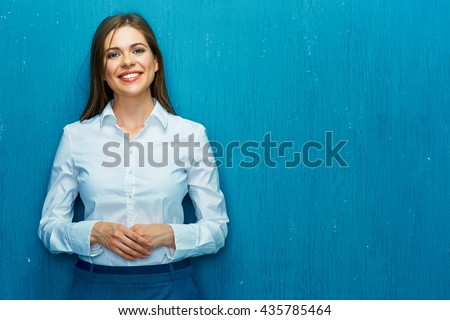 Portrait of a happy young business woman in blue shirt against white Stock photo © deandrobot