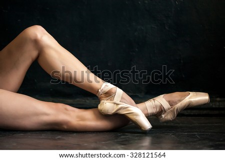 Close-up ballerina's legs and pointes on the black wooden floor  Stock photo © master1305