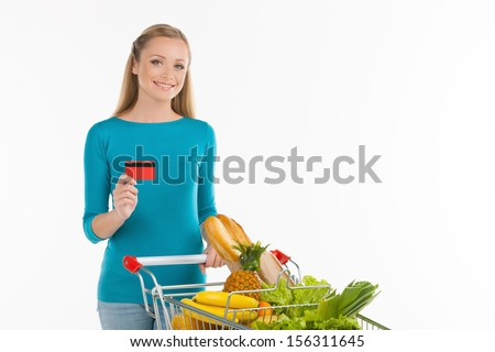 Young woman standing with shopping cart and thumb up near the ca Stock photo © vlad_star